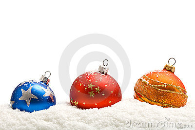 Colorful christmas baubles in the snow