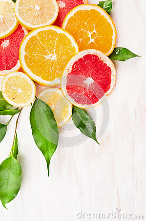 Free Colorful Citrus Fruits Slice With Green Leaves On White Wooden Background, Corner Stock Photo - 49882930