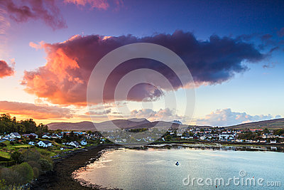 Colorful cloudscape at sunset  over a village