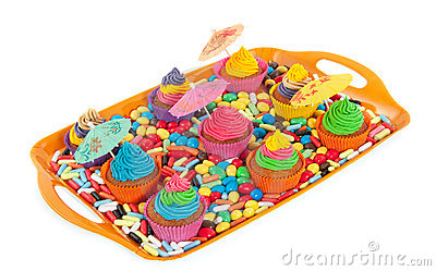 Colorful cupcakes on a tray