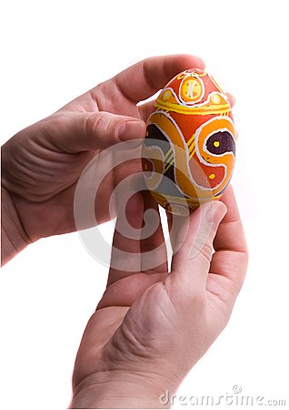Colorful Easter egg in  hands.