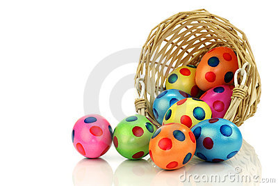 Colorful easter eggs coming from a wicker basket