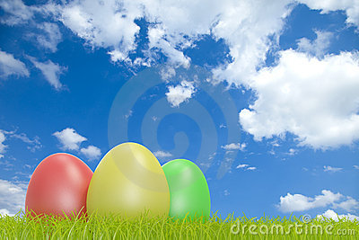 Colorful easter eggs in front of a cloudy sky