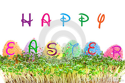 Happy Easter sign on eggs in garden cress
