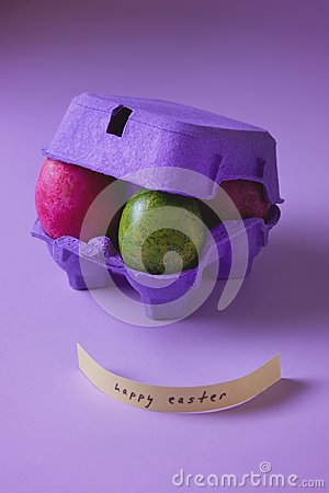 Free Colorful Easter Eggs In Purple Egg Box Royalty Free Stock Photography - 113444327