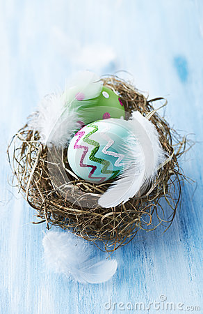 Colorful easter eggs in a nest