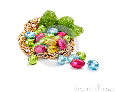 Colorful Easter Eggs in a nest with mint leaves