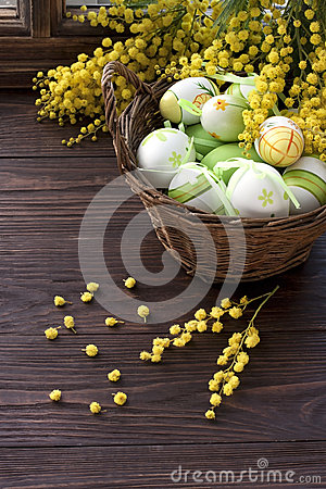 Colorful easter eggs in wicker basket Stock Photo