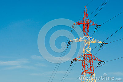 Colorful electricity pillar against blue sky