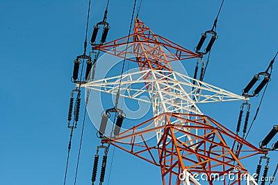 Colorful electricity pillar against blue sky