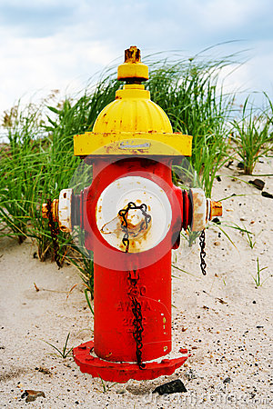 Colorful fire hydrant on the beach