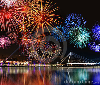 Colorful fireworks near water