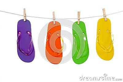 Colorful flip-flop sandles on a Clothesline