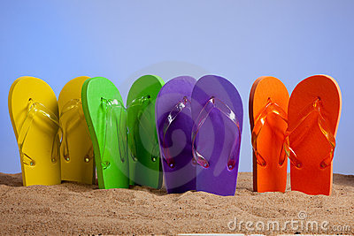Colorful Flip-Flop Sandles on a Sandy Beach