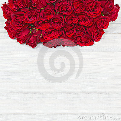 Colorful flower bouquet from red roses on white wooden backgroun