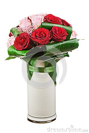 Colorful flower bouquet from roses in white vase isolated on whi