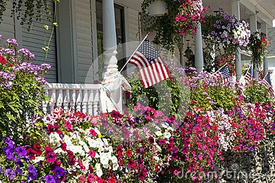 Flags and flowers on house porch