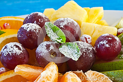 Colorful Fruits in powdered sugar