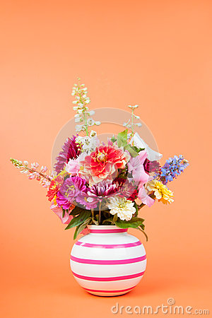 Colorful garden bouquet on orange background