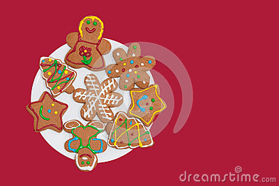Colorful gingerbread cookies on a white plate