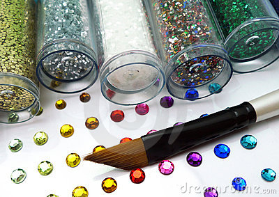 Colorful glitter and rhinestone crafts with brush
