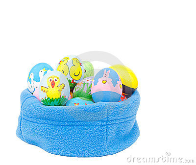 Colorful hand painted Easter eggs nested in fleece