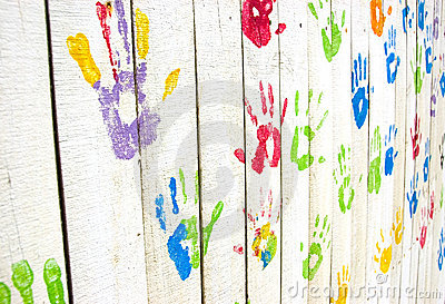 Colorful handprints on wall from an angle