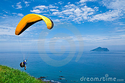 Colorful hang glider in sky