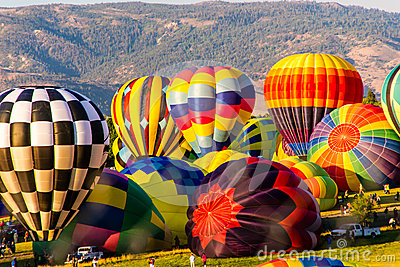 Colorful Hot Air Balloons Inflating Editorial Photography