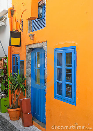 Colorful house with blue windows in Santorini