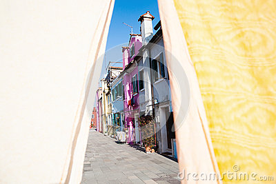Colorful houses of Burano behind linen