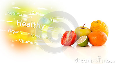 Colorful juicy fruits with healthy text and signs Stock Photo