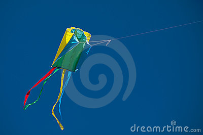 Colorful kite in blue sky