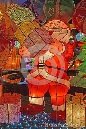 Free Colorful Light Decoration Of Santa Claus Laughing Looking Happy Carrying Piles Of Gift Boxes Stock Photography - 135456672