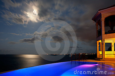 Colorful lighted home by ocean