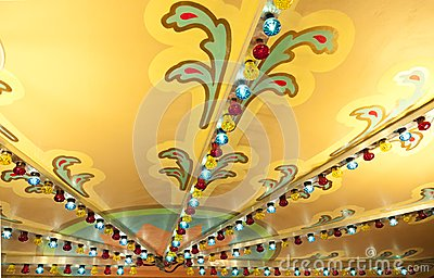 Colorful lights on carousel ceiling