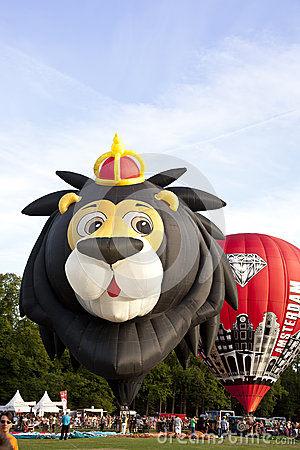 Colorful lion and red air balloons taking off Editorial Photo