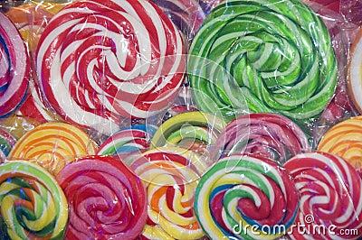 Colorful lollipops in plastic