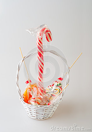 Colorful lollipops in small white basket