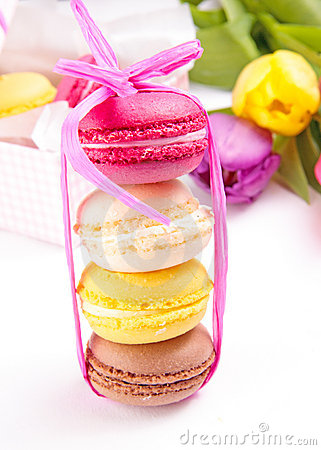 Colorful macaroons tied with ribbon