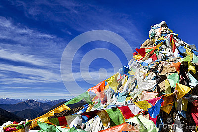 Colorful mantra flag in blue sky