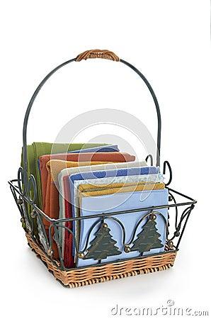 Colorful napkins in decorative basket
