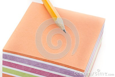 A colorful note pad with a pencil