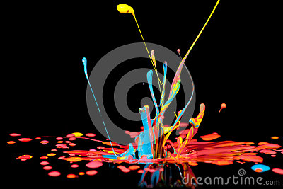Colorful paint splashing on black.