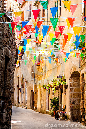 Free Colorful Party Flags Wave In A Little Alley Stock Photography - 67982312