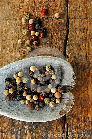 Colorful Peppercorns on a Wooden Spoon