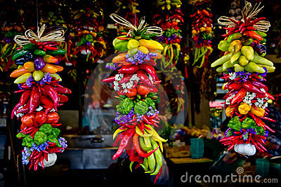 Colorful peppers and garlics hanging at market