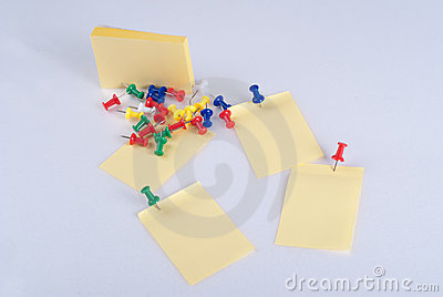 Colorful pins and yellow note