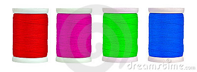 Colorful reels with thread isolated on white