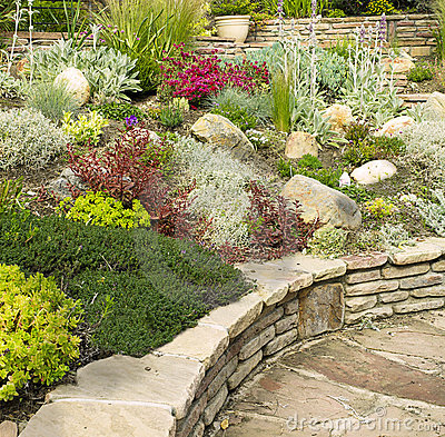 Free Colorful Rock Garden With Stone Wall Stock Image - 19907161